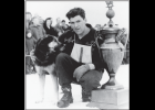 Gareth Wright posing with his lead dog after winning the 1950 ONAC.
